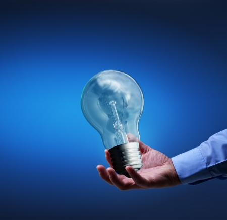 Presenting a new idea - businessman hand with old lightbulb Stock Photo - 19556757