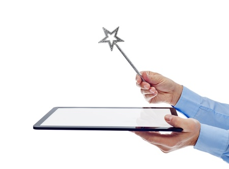 magic wand: Businessman hands with tablet computer and magic wand - isolated, copyspace