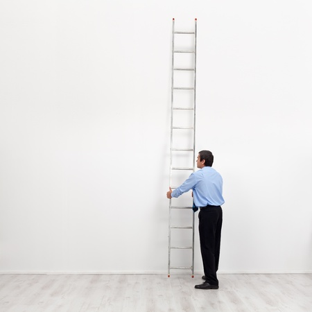 corporate ladder: The corporate ladder - businessman at the start of carrier, begin climbing Stock Photo