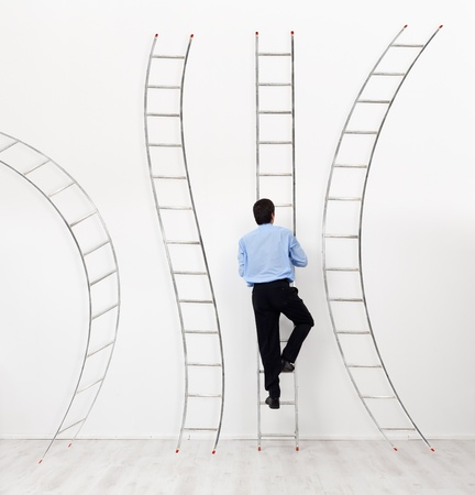 climbing ladder: Career choices and opportunities concept - businessman climbing the right ladder