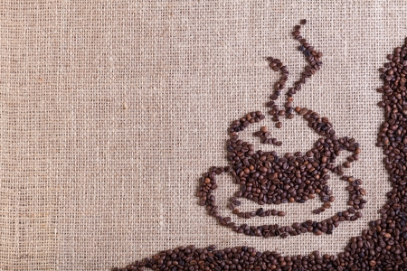 Coffee on burlap sack background with copy space Stock Photo