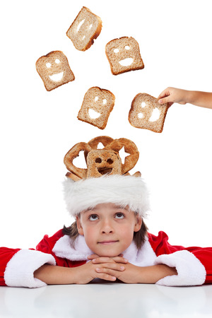 Boy dreaming of a better world at christmas time - sharing food photo