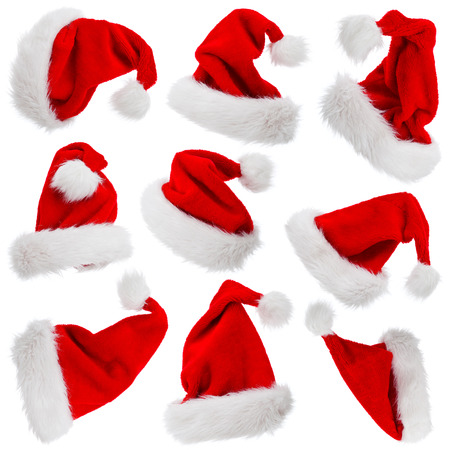 christmas hats: Furry and fluffy Santa Claus hats set isolated on white - christmas symbols