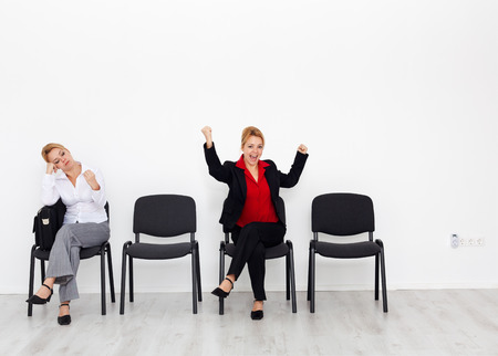 impassive: Change your attitude and change your life concept with bored and excited woman on chairs