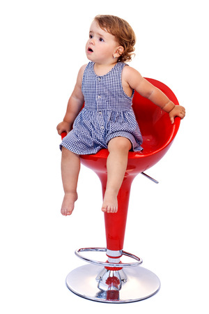 high chair: Little toddler girl on tall red bar stool - isolated