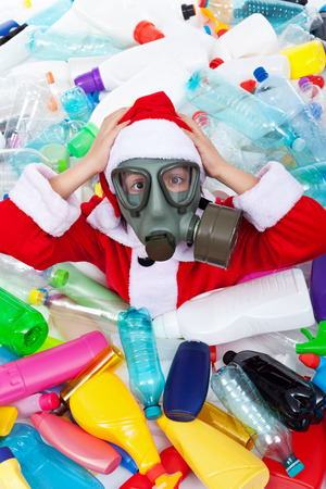 dire: Polluted Christmas - Santa covered with plastic bottles wearing gas mask