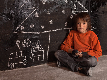 Poor kid at Christmas time on the street - sitting alone