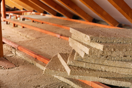 rockwool: Mineral wool stack on construction site - thermal insulation of a house