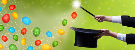 Easter magic for copy space - magician hands with black hat and wand