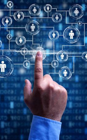 accessing: Accessing social media - businessman hand on futuristic screen Stock Photo