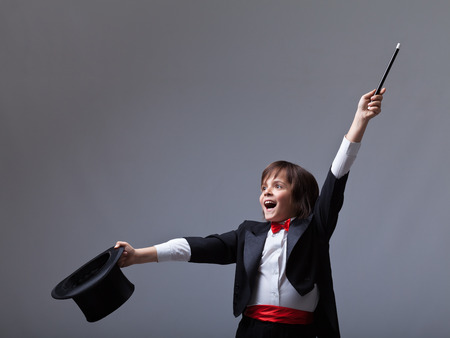 wizard hat: Young magician performing a trick - with lots of copy space