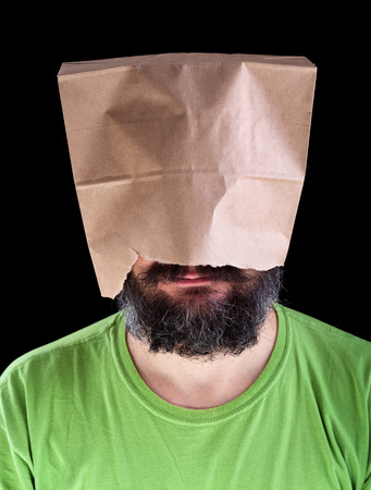 ignorance: Bearded man with paper bag on his head wearing a smile - ignorance is bliss concept