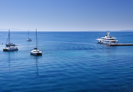 corfu: Harbor detail in Corfu town, Greece with boats on deep blue sea - copy space Stock Photo