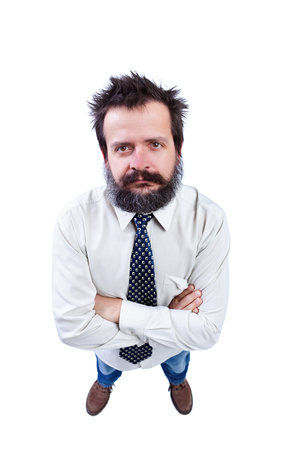 funny hair: Man with funny hair and bushy beard crossing arms and looking up - isolated