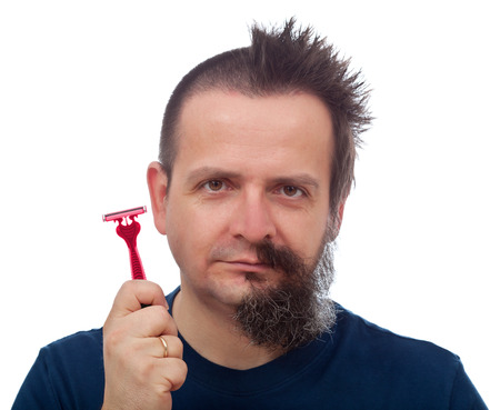 mishap: Razor efficiency mishap - man with half of head shaved off showing his red and pink disposable blade Stock Photo