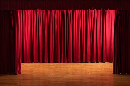 Old stage with worn floor - theatrical scene with open red curtains Stock Photo - 80698730