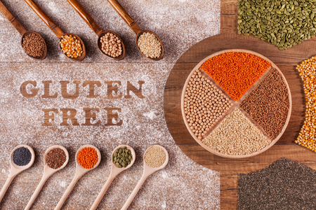 Gluten free diet options - various colorful grains and seeds on table, in spoons and plate