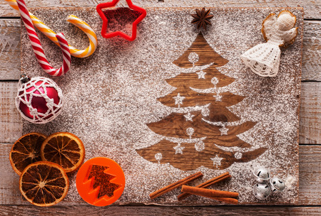 Christmas composition with seasonal sweets ingredients and xmas tree in flour 스톡 콘텐츠