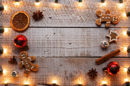 Christmas decorations and cookies setting on old wooden table - top view, with copy space