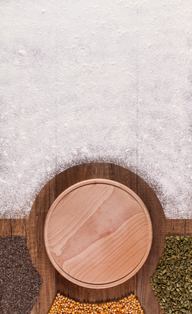 Food, cooking or menu background - nutrition concept with copy space on flour, round wooden plate and grains Standard-Bild - 118920833