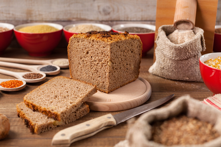 Wholgrain bread and multi grain diverse diet concept with seeds and grains in bowls and spoons