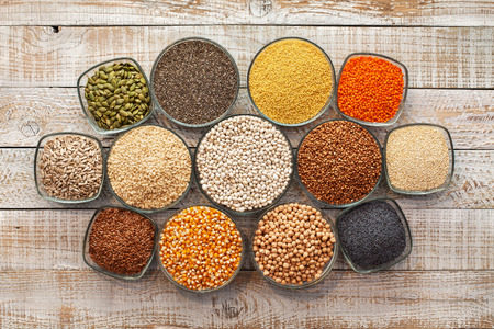 Grains, seeds and nuts collection - the gluten free alternatives. Diversified diet concept with colorful staple food variety.