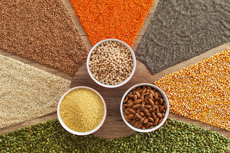Colorful grains, seeds and nuts - many healthy whole food diet choices. Variety of gluten free staple food - top view.