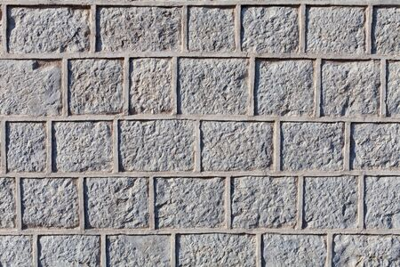 Background of graven stone blocks or bricks surface with cement grout 免版税图像