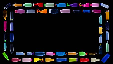 Colorful plastic waste bottles forming rectangular double frame on black backround, pollution concept - with copy space 免版税图像 - 133813939