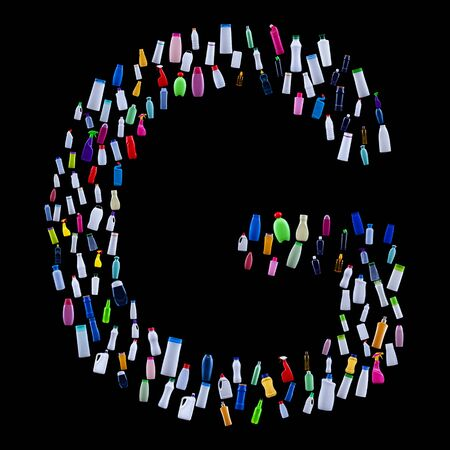 Letter G made of plastic waste bottles - pollution and ecology themed alphabet 免版税图像