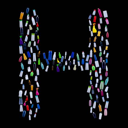 Letter H made of plastic waste bottles - pollution and ecology themed alphabet 免版税图像
