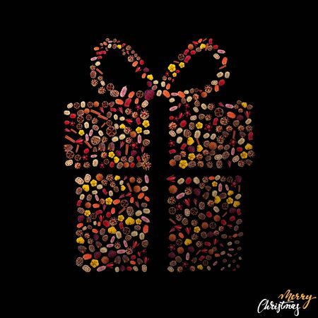 Minimalistic christmas greeting card design with natural dried xmas tree ornaments arranged in to form a present box on black background 免版税图像 - 134276616