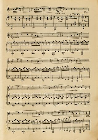 Old yellowed sheet music without lyrics - real paper texture and printing faults 免版税图像 - 140016674