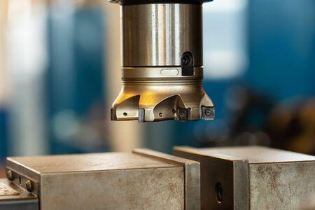 Industrial milling machine in metal workshop - close up of the work head, camera orbit
