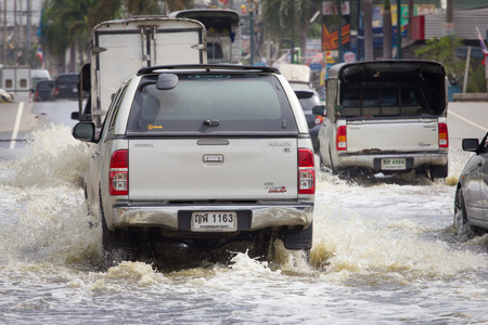 hydroplaning: Samut Prakan, Thailand  August 27, 2014: There was flooding on the street near the market in Bang Pu Industrial Estate last night after a very heavy rain.
