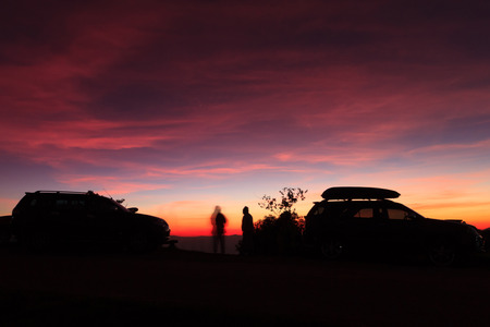 purple car: Spectacular vivid purple sunset and car silhouetted over HuenamdangForest peaks in a beautiful landscape