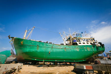 Ship waiting for repairs on a dry dock photo