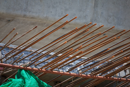 crossings: concrete piles in a construction area with rusty rebar