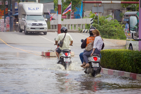 Samut Prakan, Thailand August 27, 2014: There was flooding on the street near the market in Bang Pu Industrial Estate after a very heavy rain.