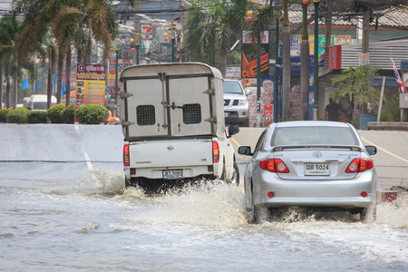 hydroplaning: Samut Prakan, Thailand August 27, 2014: There was flooding on the street near the market in Bang Pu Industrial Estate after a very heavy rain. Editorial
