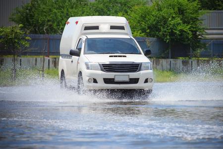 hydroplaning: Splash by a car as it goes through flood water