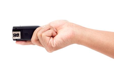 トリガー: フラッシュのトリガーを手に無線、白い背景の分離 写真素材