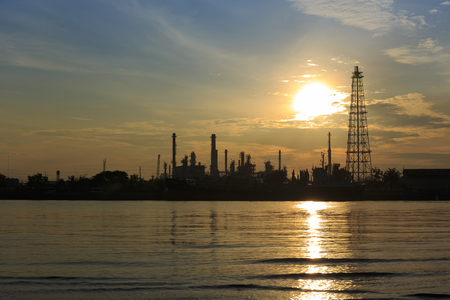 Bangchak Petroleums oil refinery in Silhouette, beside the Chao Phraya River, Petrochemical industrial with sunrise background in Phra Khanong District, Bangkok, Thailand