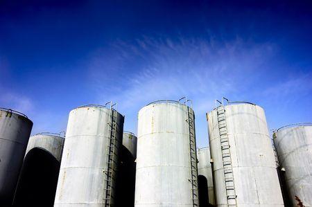 Oil tanks against the blue sky