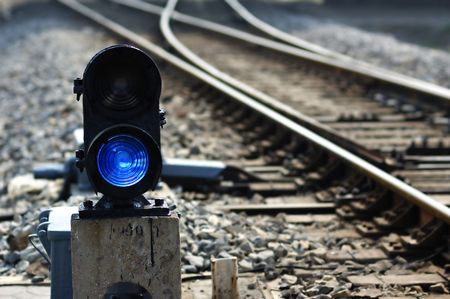 Signal lamp where railway goes to different ways Stock Photo
