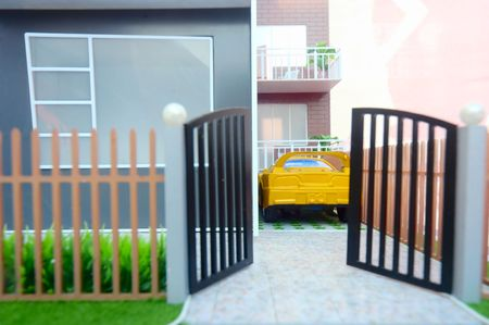 fense: Yard of home(shallow depth of field,focus on house and car)