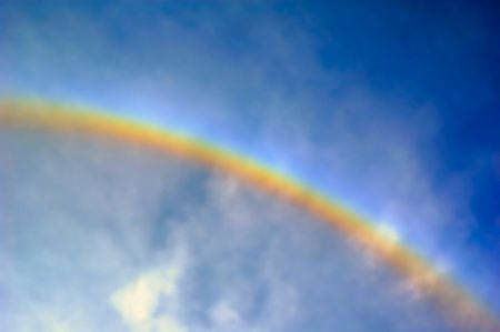 Rainbow  in blue sky photo