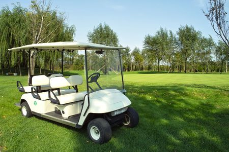 golf cart: Golf cart on golf course