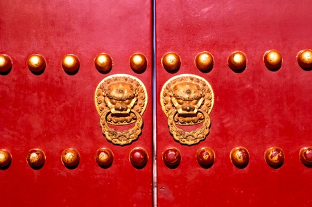 Iconic door with its protecting lions. The entrance of the Temple of Heaven, Beijing, China.