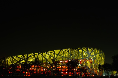 Beijing, China - April 26, 2011: The Beijing National Stadium( the Bird's Nest) lights up. As a landmark of modern China, which attracting million of tourists each year. Stock Photo - 9444888